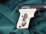 Beretta Tomcat Ultima Panel Bonded Ivory with Landing Eagle with Branch Scrimshaw on Both Sides