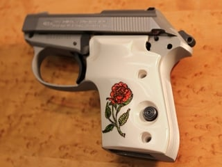 Beretta Tomcat Ultima Panel Bonded Ivory with Rose Scrimshaw on Both Sides